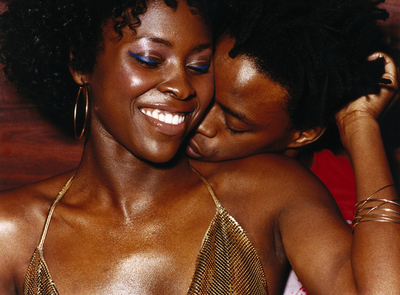 Man Kissing Woman's Neck